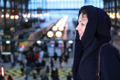 Woman close up stands in train station Stock Images