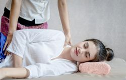 Woman with closed eye getting massage on spa bed Stock Images