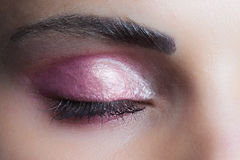 Woman closed eye with perfect pink  wet eyeshadow closeup studio Royalty Free Stock Photo