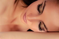 Woman with closed eyes Stock Photography