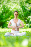 Woman with closed eyes in asana position prayer gesturing Royalty Free Stock Photography