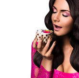 Woman with closed eyes eating cake Stock Photography