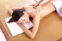 Woman closed eyes and enjoy massage Stock Photography