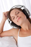 Woman with closed eyes enjoying music Stock Photography