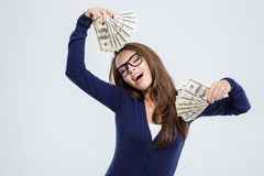 Woman with closed eyes holding money Stock Images