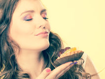 Woman closed eyes holds cake in hand Stock Images