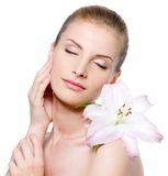 Woman with closed eyes and with lily Stock Image