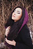Woman with closed eyes with purple scarf Stock Photography