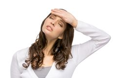 Woman with closed eyes touching her head Royalty Free Stock Image