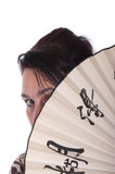 Woman is closed by a fan. On a white background Royalty Free Stock Image