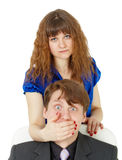 Woman closed mouth to man Stock Photos
