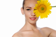 Woman closed one eye yellow flower of a sunflower Stock Photo