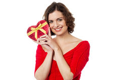 Woman closely holding gift from her boyfriend Royalty Free Stock Images