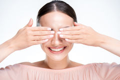 Woman closes eyes with hands Royalty Free Stock Photo