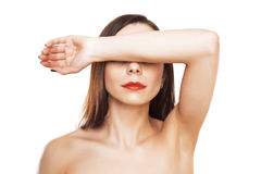 Woman closes eyes with her hand Stock Images