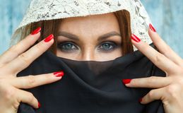 Woman. Closeup of beautiful woman with shawl over her head. caucasian woman dressed in oriental style Royalty Free Stock Photos