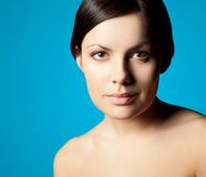 Woman closeup face over blue stock image