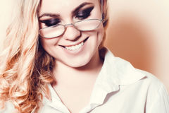 Woman closeup in glasses smiles broadly Royalty Free Stock Photos
