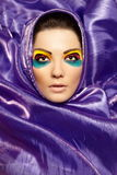 Woman closeup portrait bright makeup purple colour Stock Photos