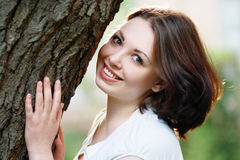 Woman closeup portrait near tree Royalty Free Stock Photos
