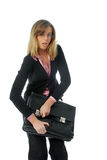 Woman closing bag. Young attractive businesswoman in glasses trying to close her bag. Caught in the act Royalty Free Stock Image