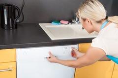 Woman Closing Dishwasher Royalty Free Stock Image