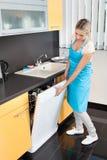 Woman Closing Dishwasher Stock Photo