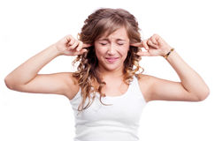 Woman closing ears Royalty Free Stock Image