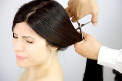 Woman closing eyes scared of haircut Stock Photo