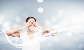 Woman closing eyes Stock Images