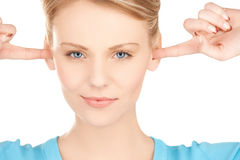 Woman closing her ears with fingers Stock Image