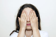 Woman closing her eyes with hands Royalty Free Stock Photos