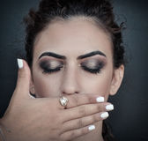 Woman closing her mouth with her hand Royalty Free Stock Images