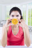 Woman Closing her Mouth with Orange Slice Royalty Free Stock Photo