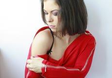 Woman closing her zipper Stock Photography