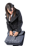 Woman is closing a Suitcase Royalty Free Stock Image