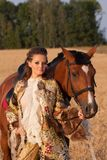 The woman in clothes of 18 centuries with horse Stock Photography