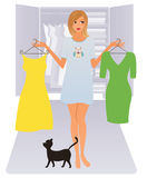 Woman with clothes. Attractive woman deciding what to wear Stock Photo