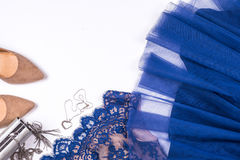 Woman clothes and accessories. Soft blue colors female apparel. Pale colors fashion set stock photos