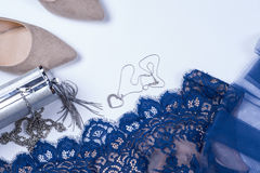 Woman clothes and accessories. Soft blue colors female apparel. Pale colors fashion set royalty free stock photo
