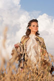 The woman in clothes of 18 centuries with dog Stock Image
