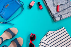 Woman clothes collection, sea theme, overhead. Summer female clothing in sea theme on bright background, copyspace royalty free stock photography