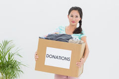 Woman with clothes donation Stock Images