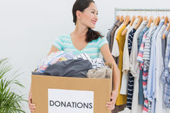 Woman with clothes donation Royalty Free Stock Photos