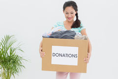 Woman with clothes donation Stock Photos