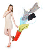Woman with clothes flying into the bag Royalty Free Stock Images