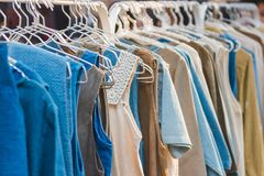 Woman clothes on hangers for sale in market. Bangkok Thailand Stock Photo