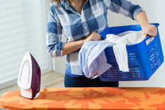 Woman with clothes before ironing Stock Photography