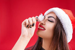 Woman in clothes of Santa Claus red background. cartoon. Sexy woman in clothes of Santa Claus clown and fooling around on a red background. cartoon Stock Images