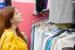 Woman  at clothes shop Royalty Free Stock Photo